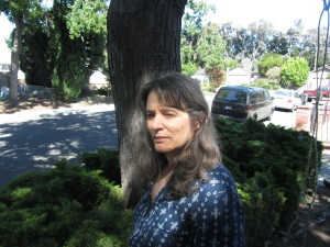 Deborah Olenev in front of tree.