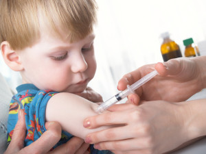 child being vaccinated
