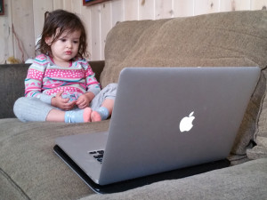 Child Looking at the Computer.